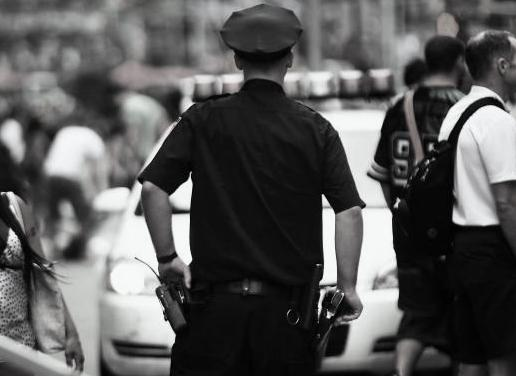 176418000-new-york-city-police-officer-stands-in-times-square-on.jpg.CROP.promo-mediumlarge